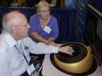 Photo of Prof. Fred Brooks trying a maglev haptic device