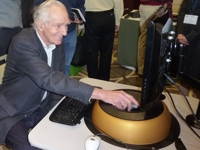 Photo of Prof. James Livingston trying a maglev haptic device